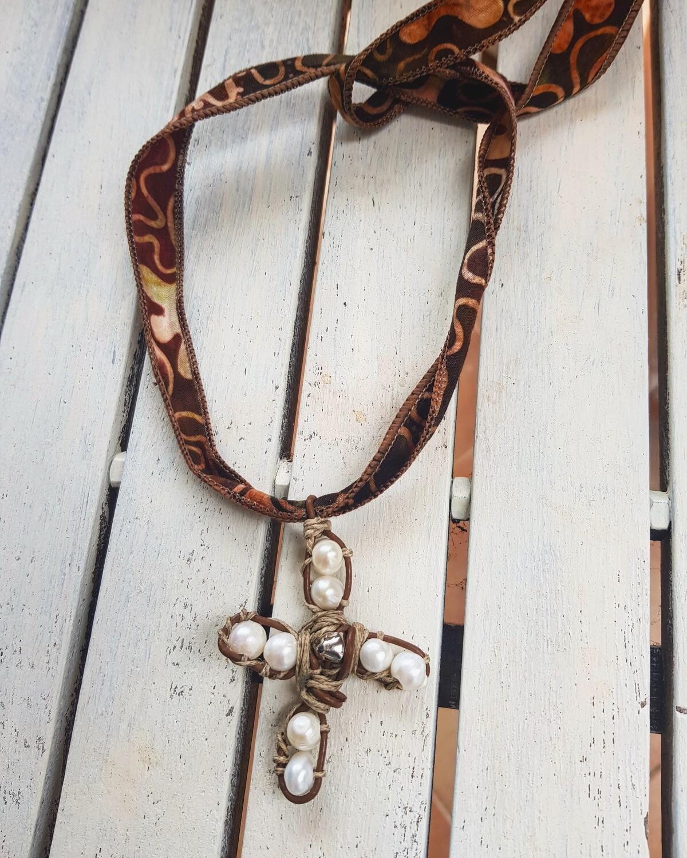 Cruz perlas
