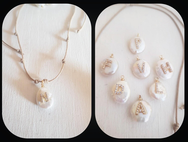 Inicial perla