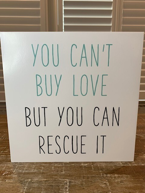 Box Sign: 'You Can't Buy Love But You Can Rescue It'
