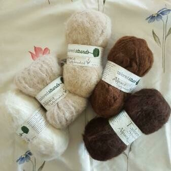 Brushed 12ply Naturals 100% Australian alpaca yarn -ivory, champagne, sandstone, redwood, mocha brown.  Luxuriously soft on the skin.