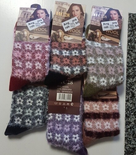 Angora Socks - made from the combed-out fibre of the long coated fluffy angora rabbit. Luxuriously soft & durable.  Priced at only $6.99 a pair. They should be $10/pair.  Small/ladies sizing