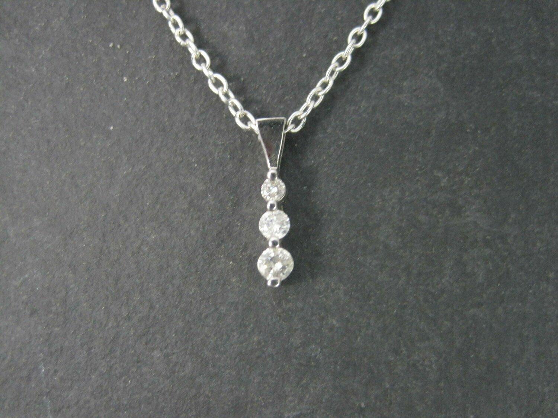 Vintage 10K .28 Carat Graduated Diamond Pendant