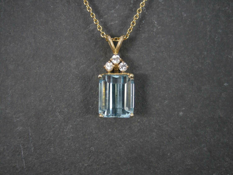 Estate 14K 14.8 Carat Blue Topaz Diamond Pendant