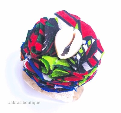 Psychedelic funk print carnation ruffle flower | ankara flower with cowrie shell centre| flower pin | flower hair clip | flower brooch