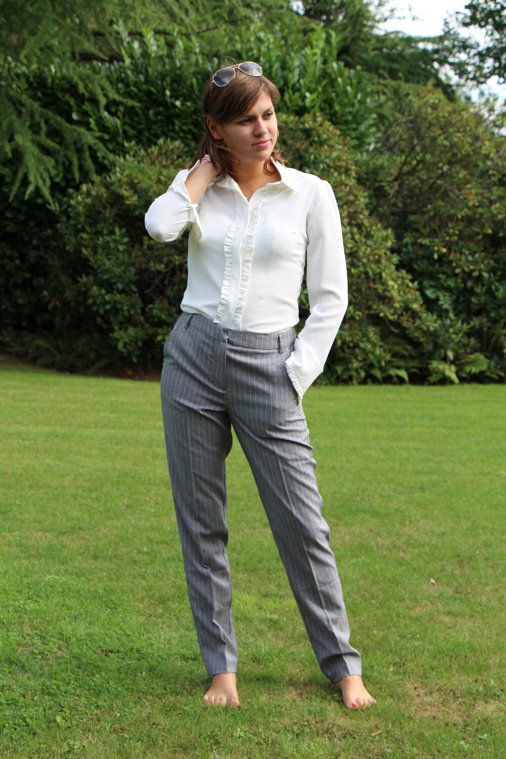 Grey pants with thin white stripes