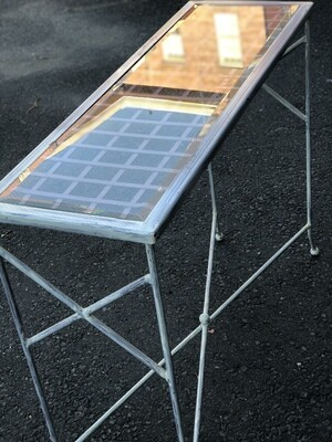 Glass topped metal table