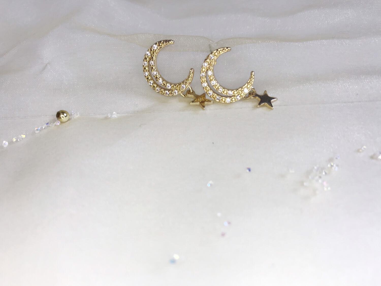Ανοξείδωτα σκουλαρίκια με κρεμαστό αστέρι και στρας
