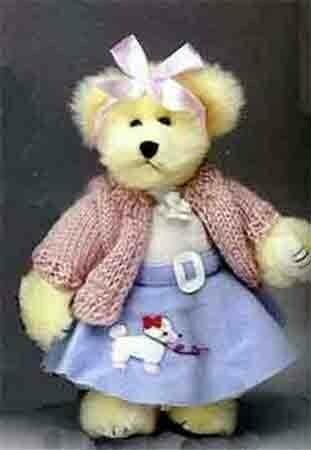 Teddy bear wearing poodle skirt