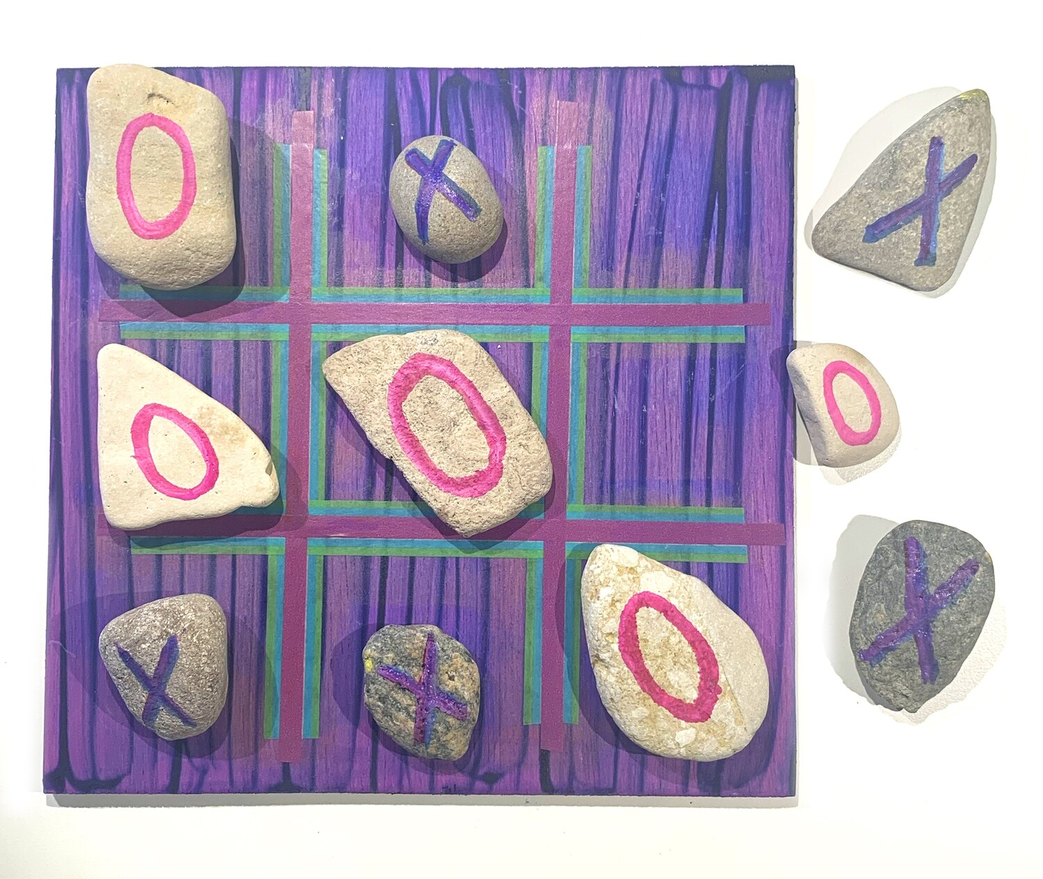 Tick tac toe rock painting