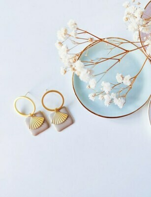 Isa & Roza | Golden palm hoops with sand pendant