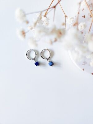 Isa & Roza | Silver dotted mini hoops with dark blue stone
