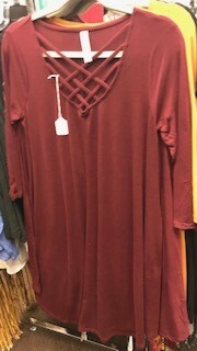 Apparel/dress/3/4 length sleeve/criss cross neck/rust sz. small, med and large