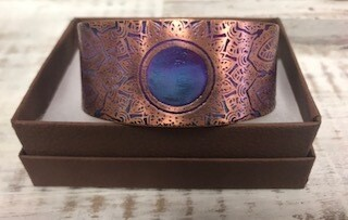 Bracelet/Handcrafted/copper metal with bluish medallion in middle