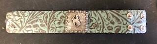 Bracelet/Wyo steamboat concho/silver/aqua & brown tooled leather