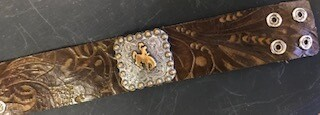 Bracelet/Wyo steamboat concho/gold on silver background/brown tooled leather