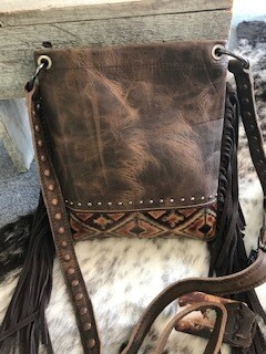 Montana West/distressed brown leather crossbody bag/tooled leather design at bottom of bag/brown fringe