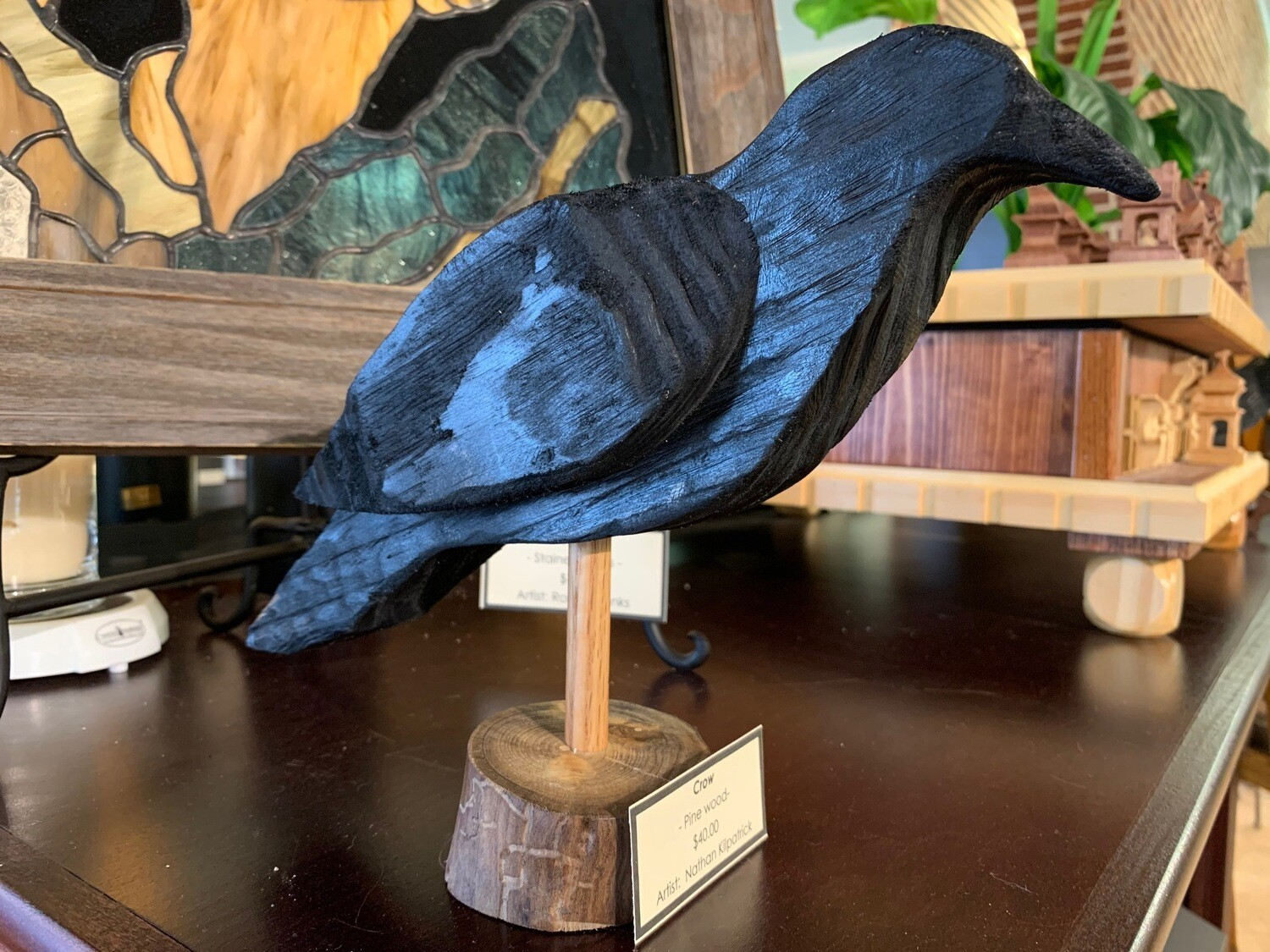 Hand-carved wooden Crow