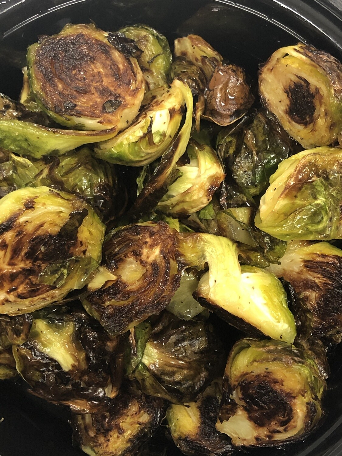Glazed Brussel Sprouts Family Side - 16oz roasted brussel sprouts tossed with honey, cider, salt and pepper. Family of 4.