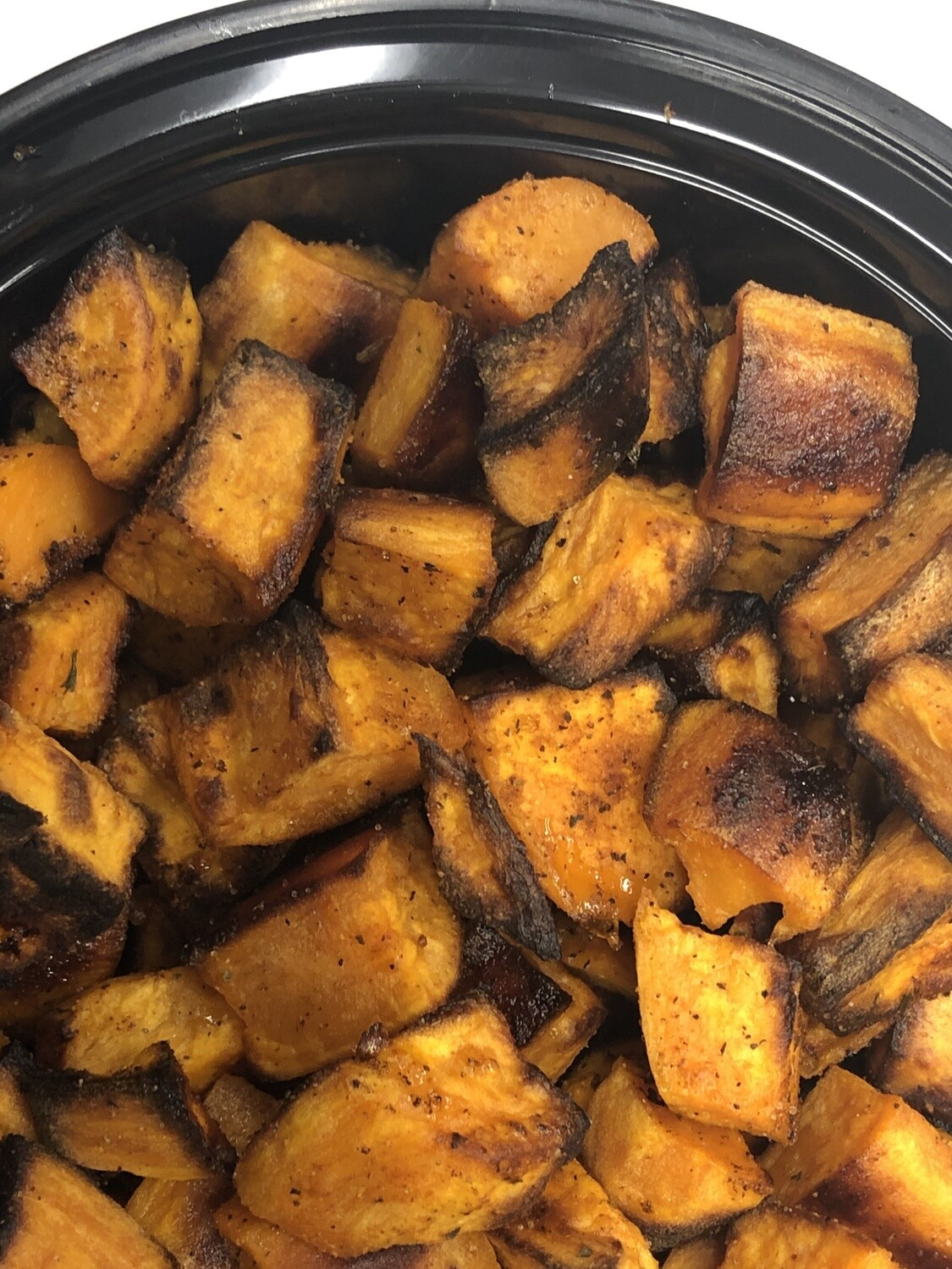 Sweet Potato Family Side - 16oz roasted sweet potatoes lightly seasoned with brown sugar and chili powder. Family of 4