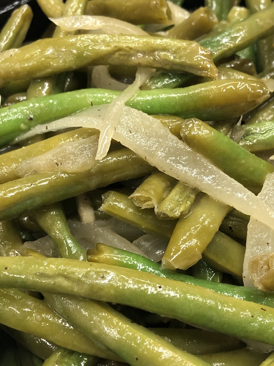 Sauteed Green Beans Family Side - 16oz green beans sauteed with onions and garlic, finished with lemon. Family of 4.
