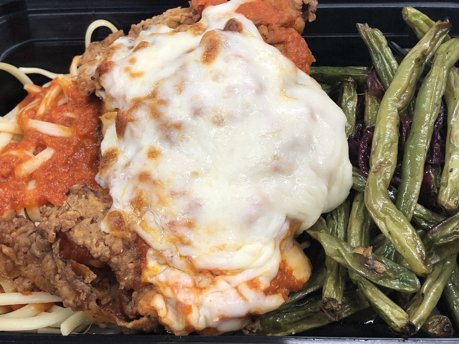 Chicken Parmesan Meal for One- Breaded chicken breast and linguine with house made marinara. Topped with melted mozzarella Served with Sautéed Green beans