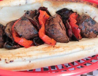 STEAK SPIEDIE SANDWICH - Cubed steak marinated in spiedie sauce with grilled onions, peppers, and provolone cheese on a french roll.
