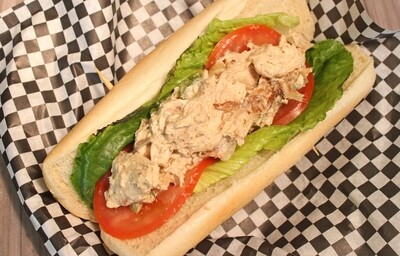 Caramelized Onion Chicken Salad-Chicken salad with caramelized onions, Dijon dressing, lettuce, and tomatoes, on a French roll.