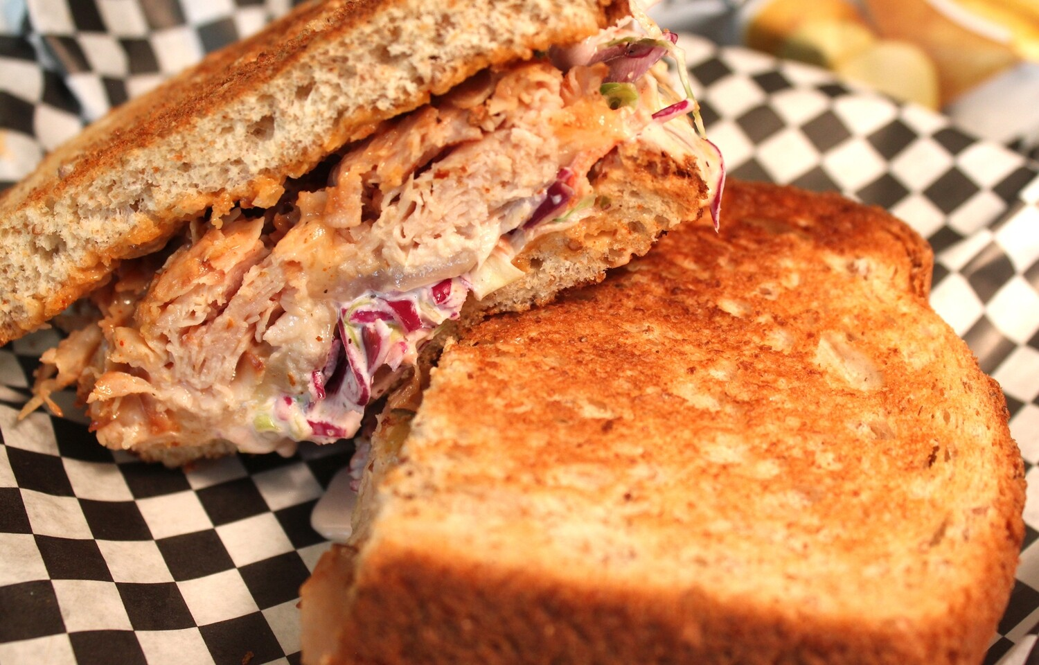 Grilled Rachel- Turkey, House made Slaw, Russian Dressing, Swiss Cheese, Grilled on Wheatberry Bread