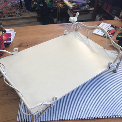 cream metal tray with bird