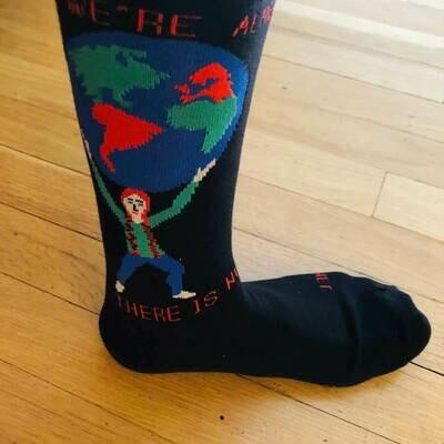 Maggie Stern Girl Holding Earth Socks