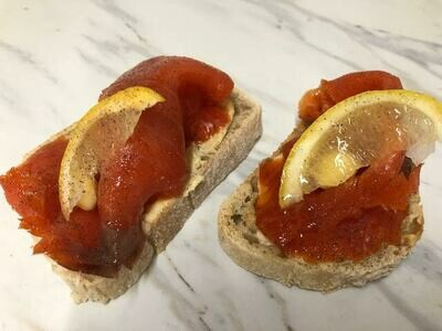Smoked salmon with a lemon sour cream on a baguette toast