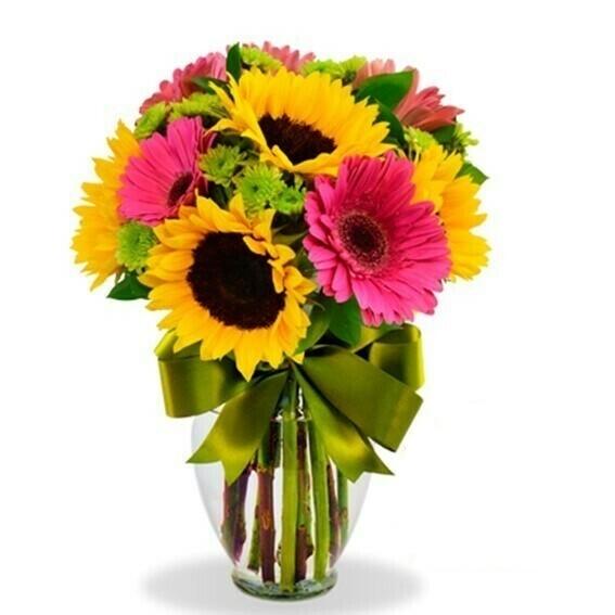 Bella Girasoles y gerberas en florero