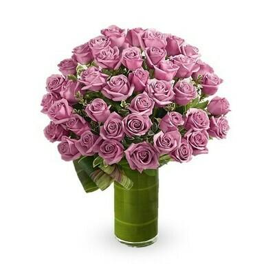 Stiva | rosas malva en florero
