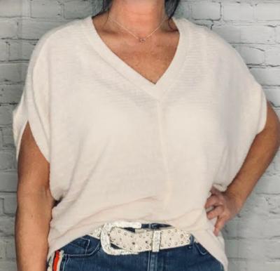 Sinuous cream dolman sleeve shirt