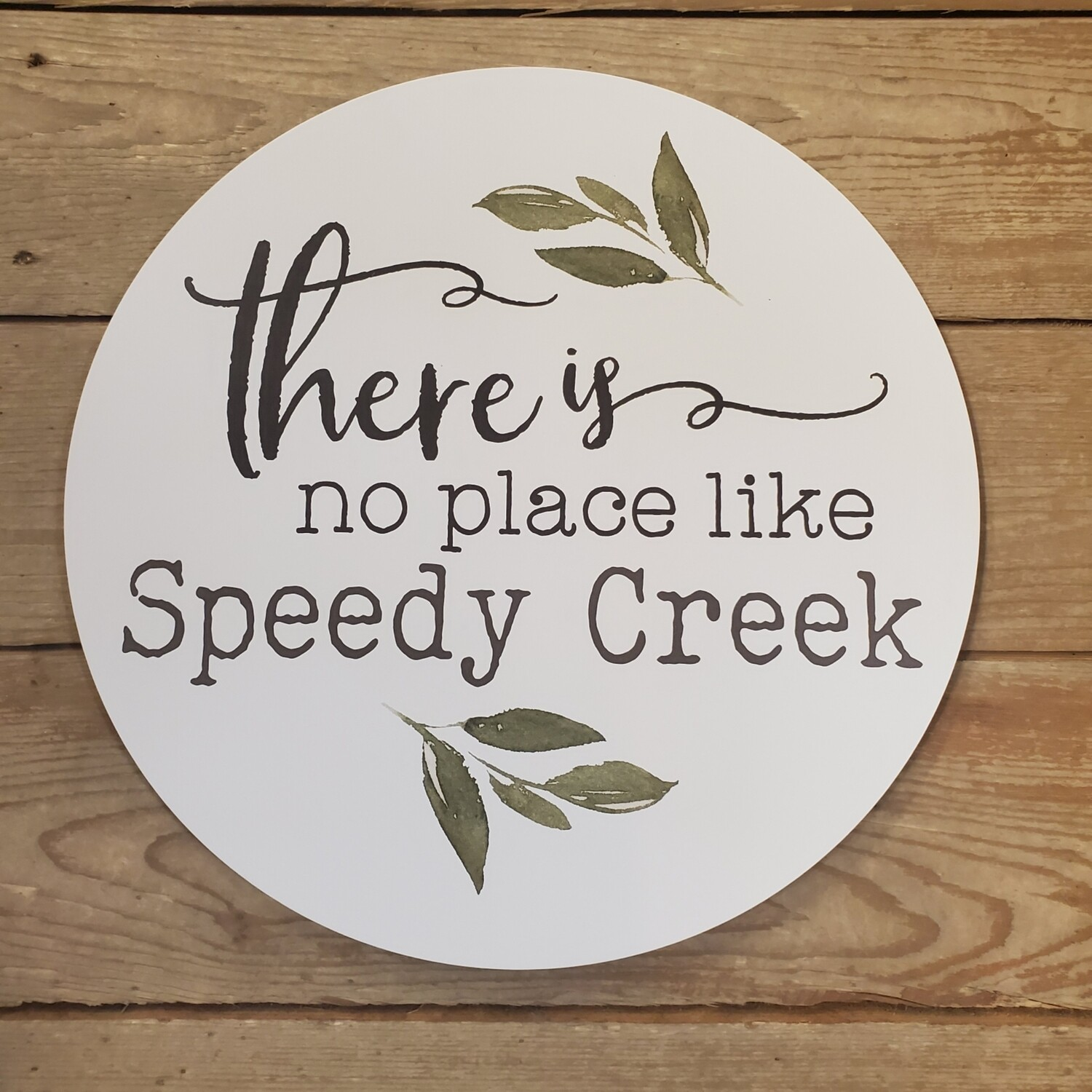 """There's No Place Like Speedy Creek "" Round Wood Sign"
