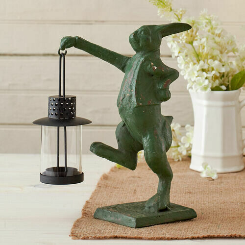 Cast iron rabbit with lantern