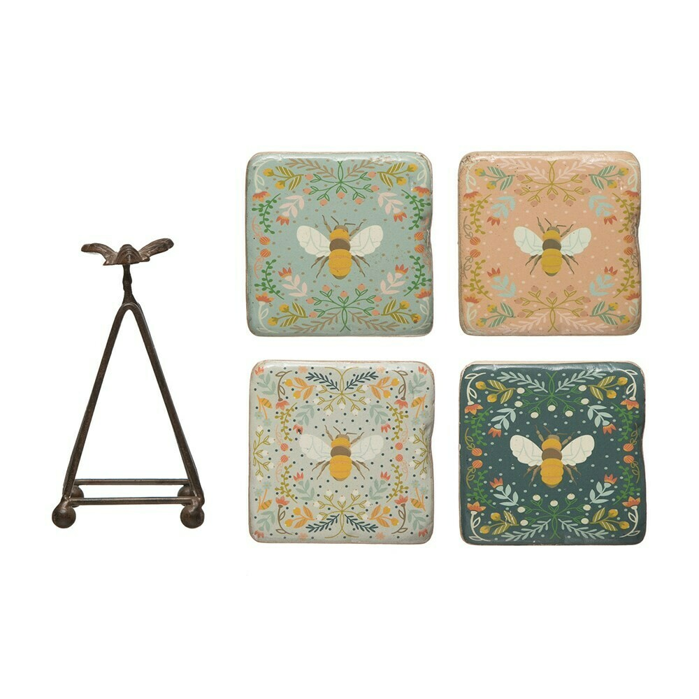 Resin coasters with bees in metal stand