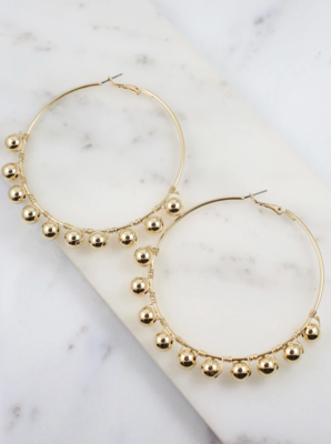 Ritcher gold hoop earring with ball accents