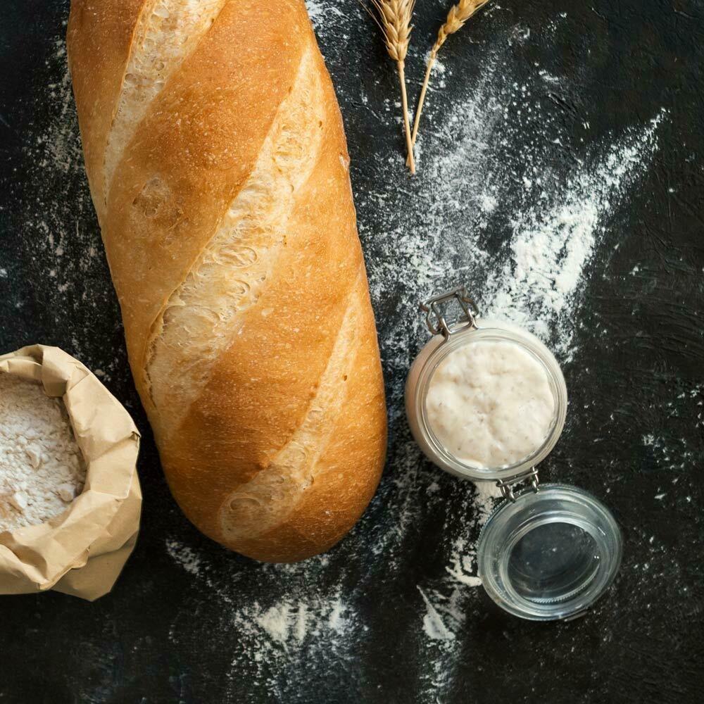 Zuurdesem stokbrood met kruidenboter