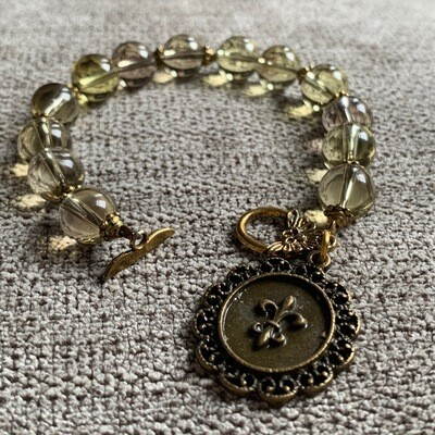 With Charm and Clasp