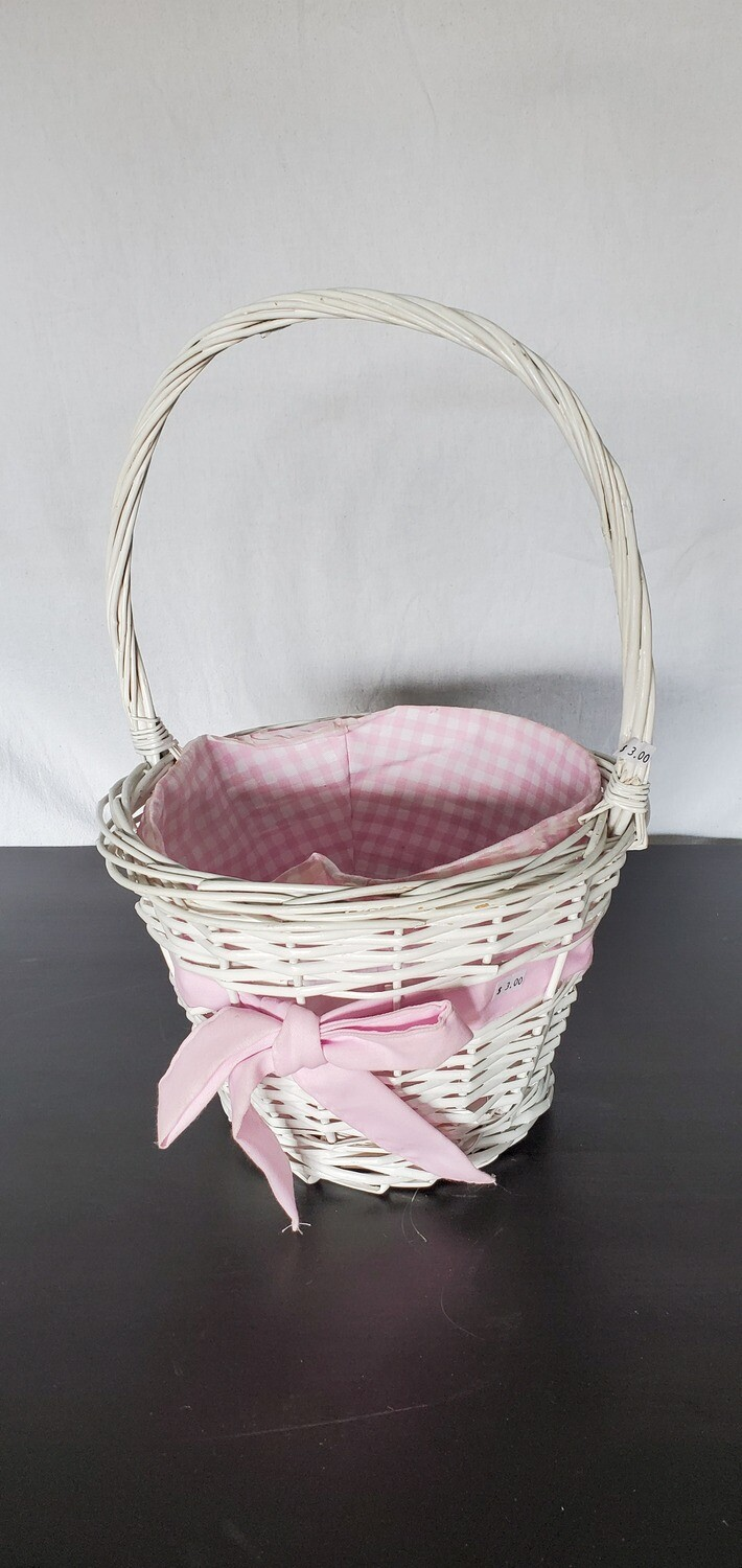 White wicker basket w/ pink bow