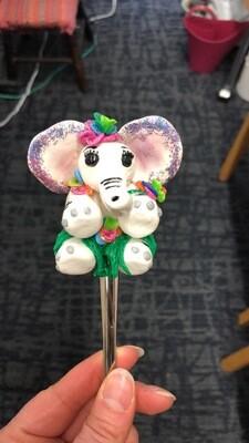 White elephant spoon