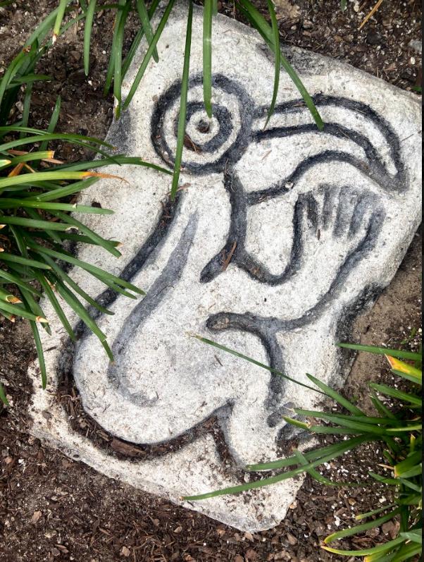 Birdman carving (concrete)