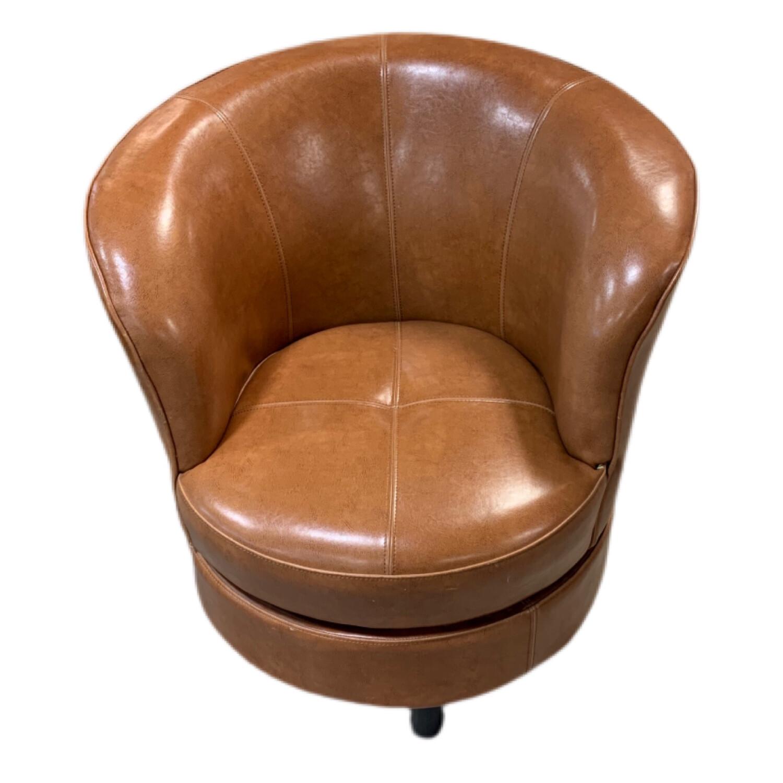 Brown Circular Rotating Arm Chair