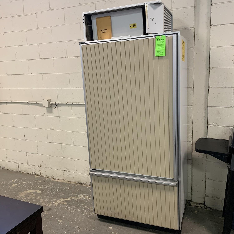 Subzero Refrigerator With Beige Paneling