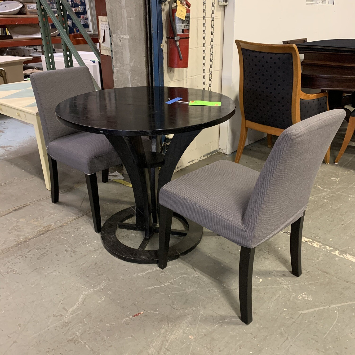 Round Black Table With 2 Silver Grey Chairs