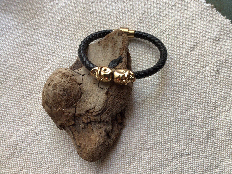 Bracelet: Gold Tone Skulls