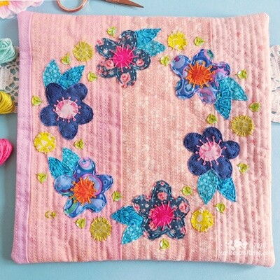 Blue appliqué flower wall hanging