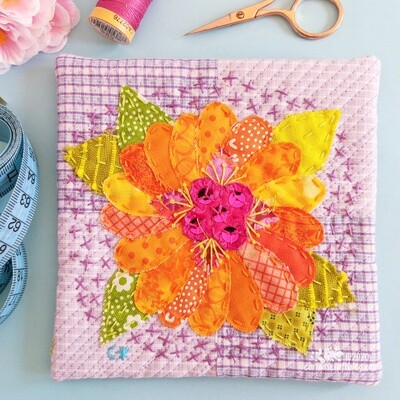 Orange appliqué flower wall hanging