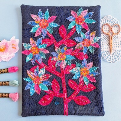 Aqua and blue appliqué flower wall hanging